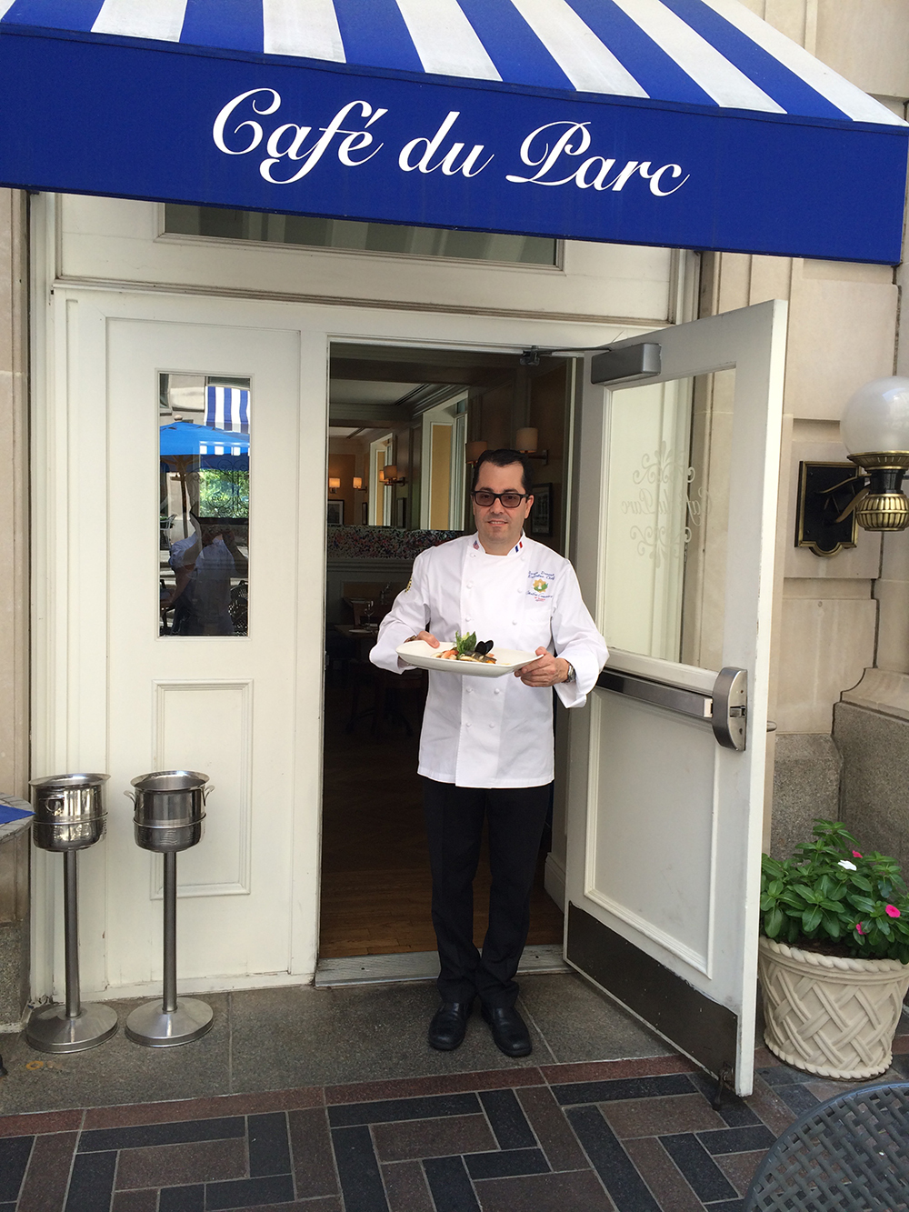 MCF Chef Serge Devesa at the entrance of Cafe du Park in Washington DC